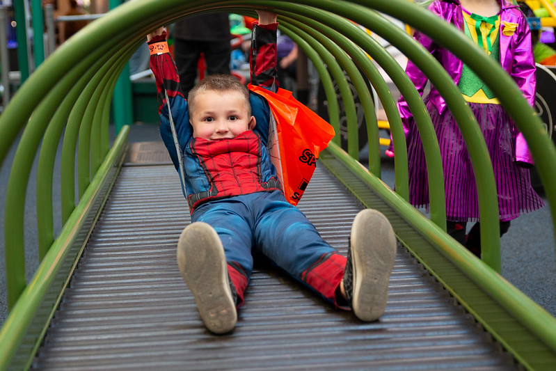 Child During Spookfest playing in Roller Slide